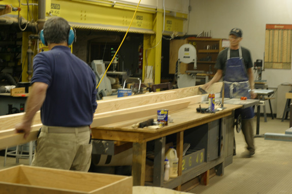 Carpenters Mike Crawford and Steve McGovern help with the boxcar project