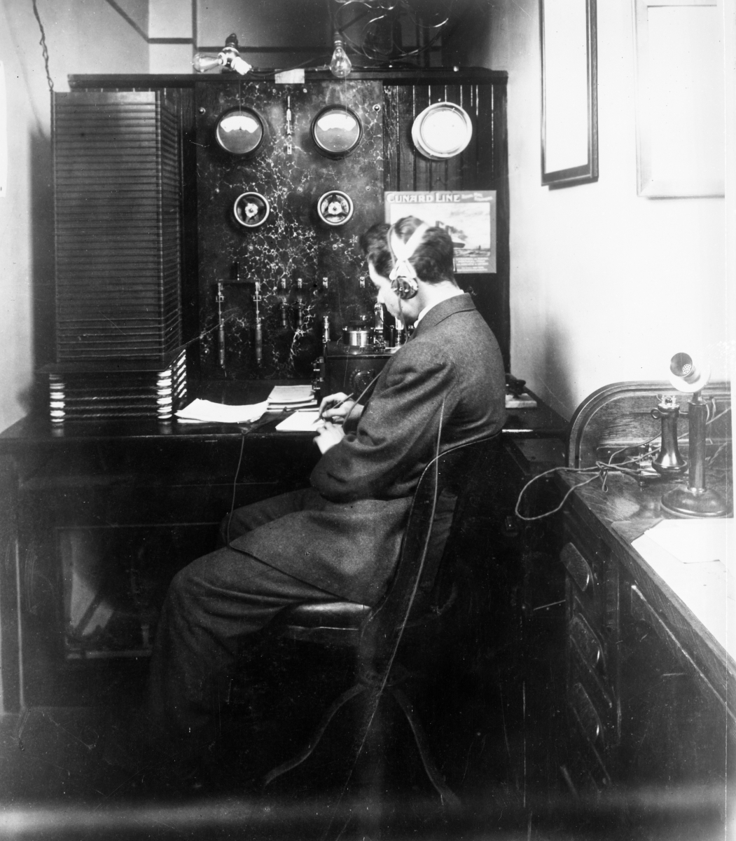 Sarnoff in 1912 working with headphones on