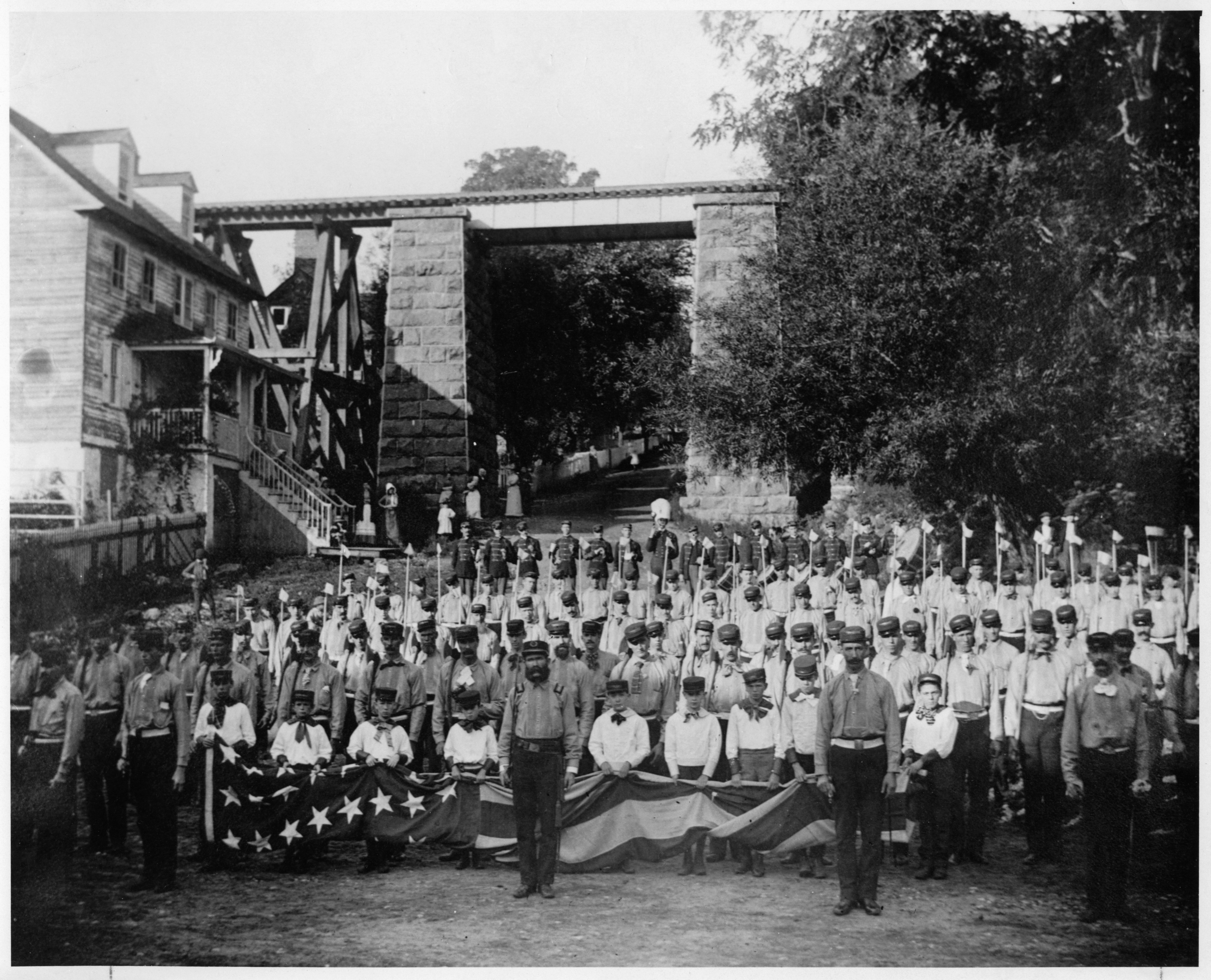 """Black and white group photo of the """"Tippencanoe"""" Harrison and Morton Club of Du Pont's Banks"""
