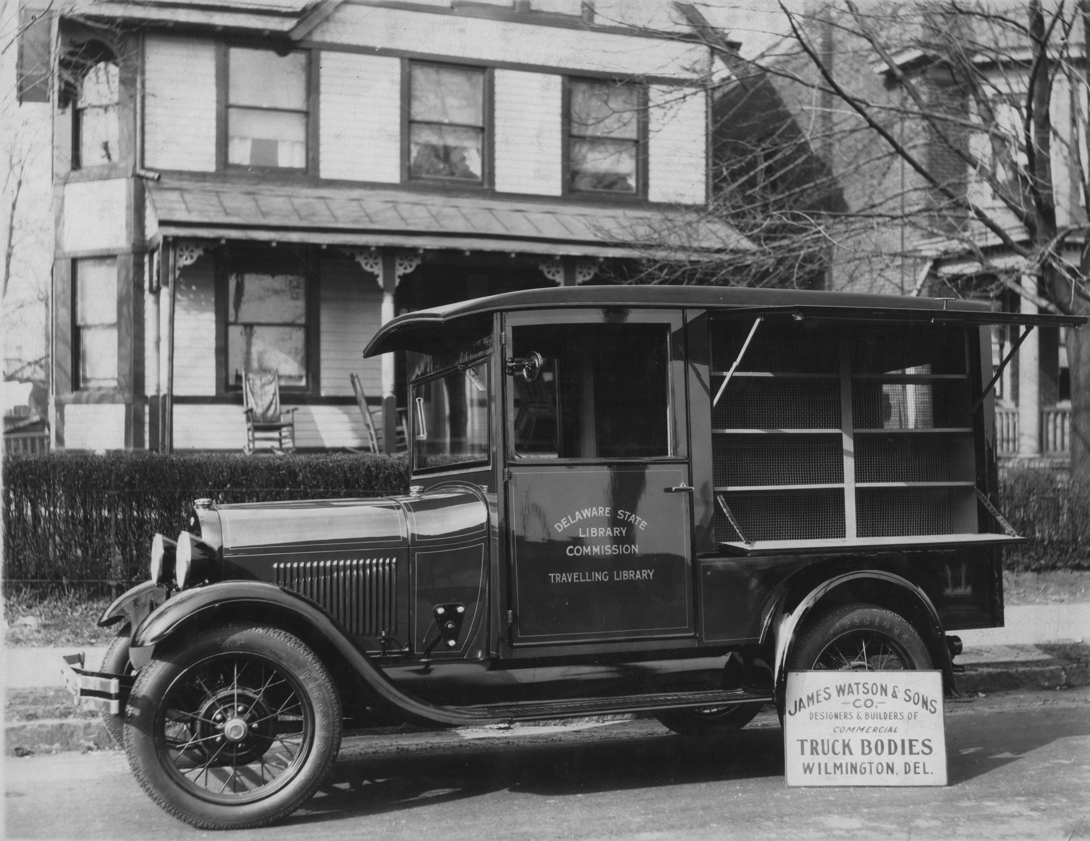 Black and white photo of a bookmobile, circa 1920s, run by the Delaware State Library Commission.