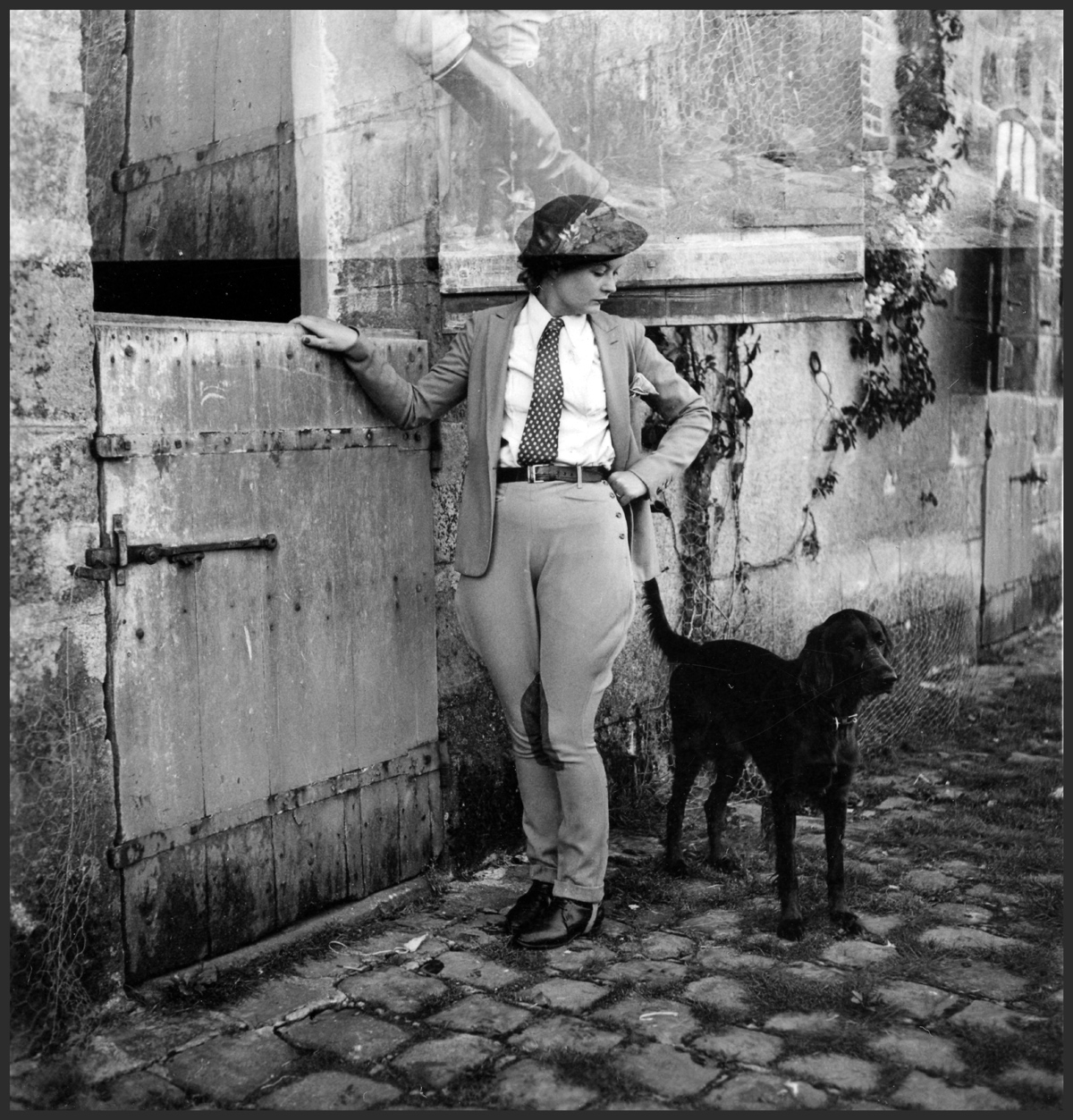Black and white photo of a woman and dog, likely circa 1935.