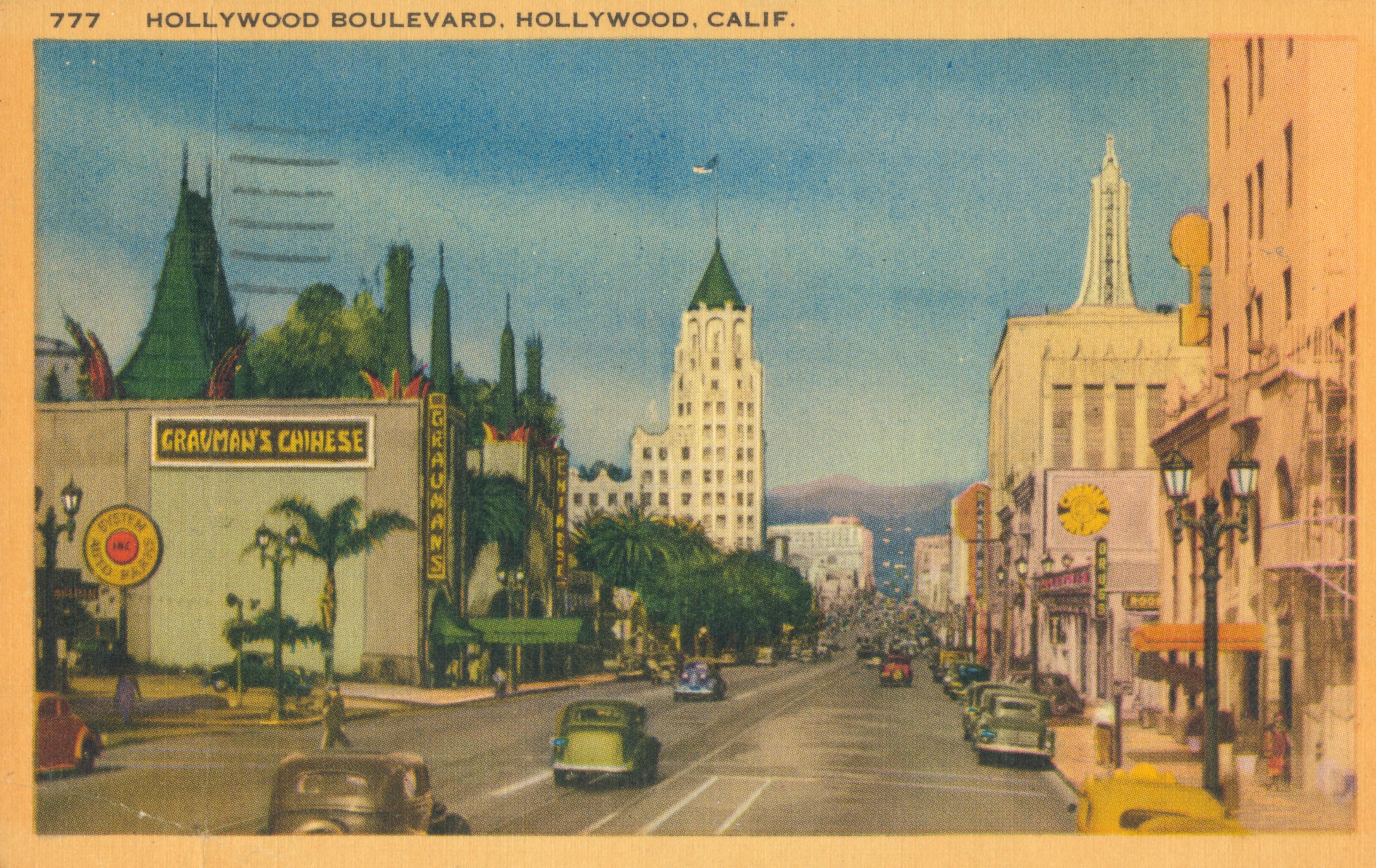 Colorized postcard of Hollywood Boulevard, California.