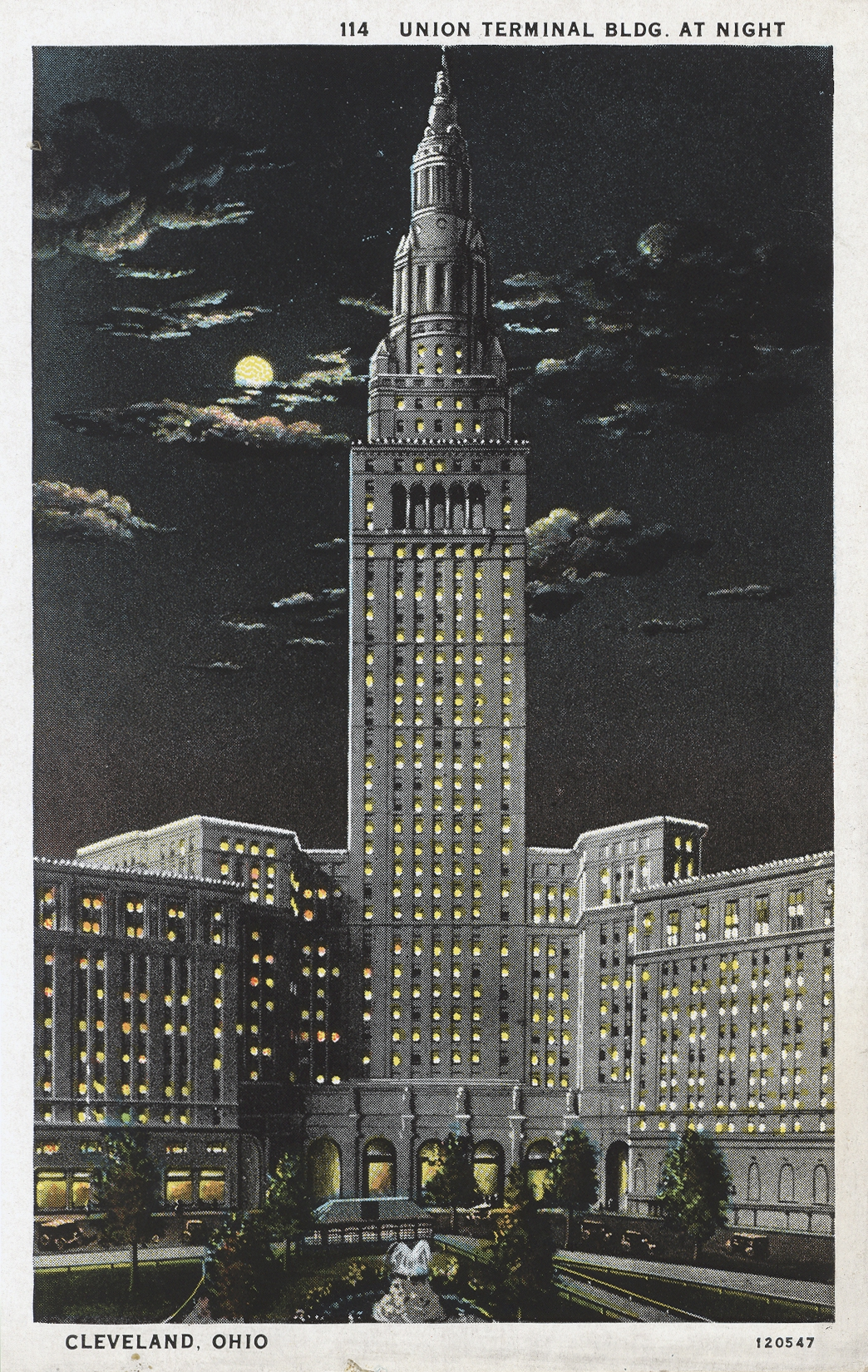 Postcard with a color illustration of the Union Railroad Terminal building at night.