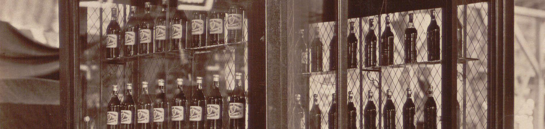 Whisky in bottles and barrels