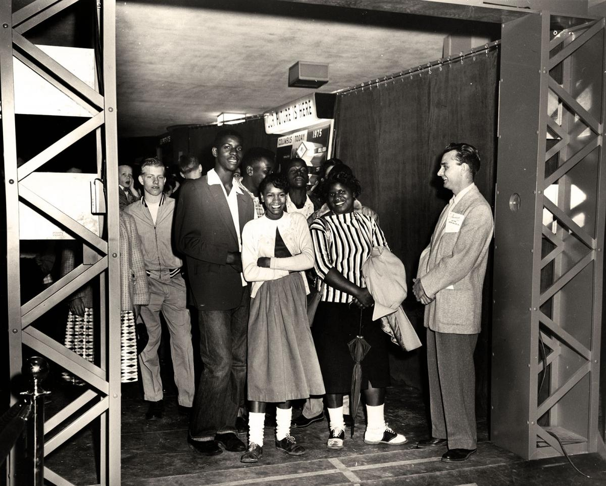 Teens line up to enter the exhibit