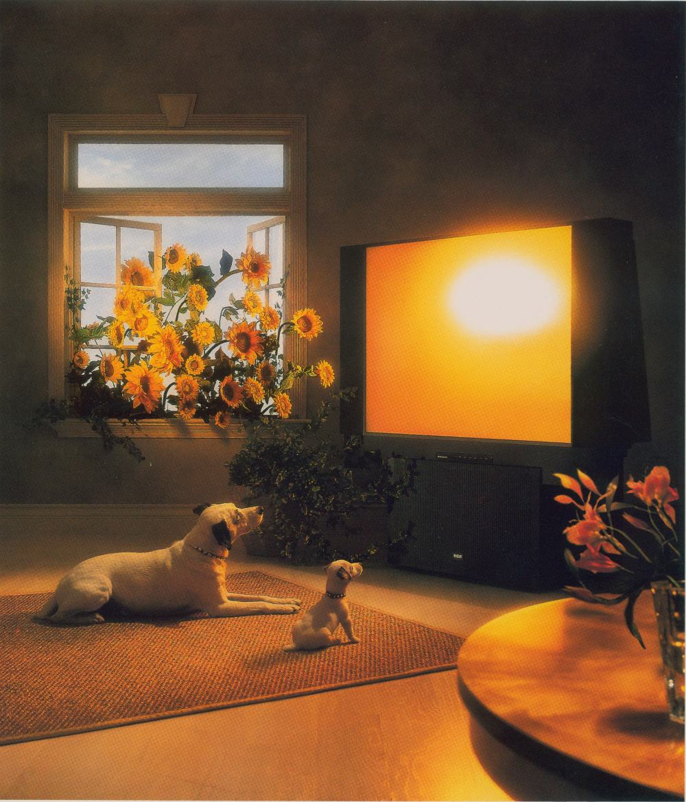 An ad featuring Chipper and Nipper watching tv as sunflowers burst through the nearby window