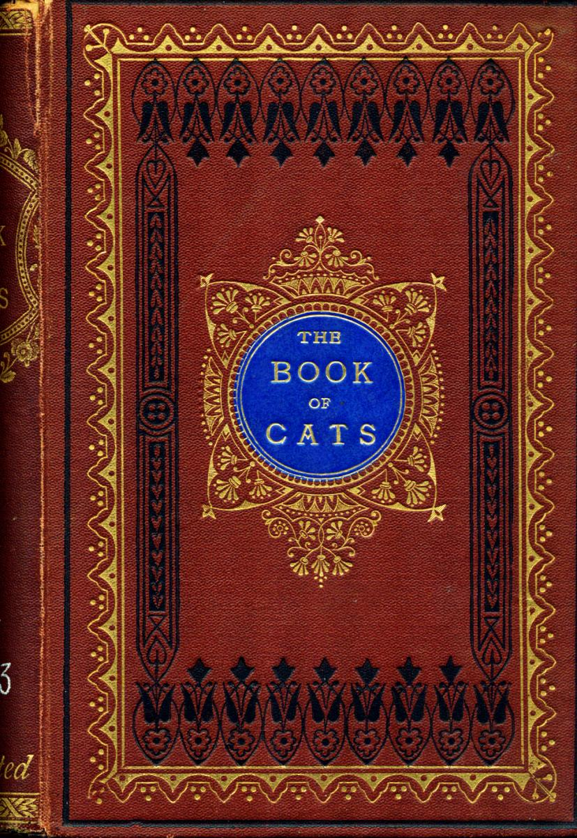 "A red book with intricate patterns in black and gold. The center has a circle with the title ""The Book of Cats"""