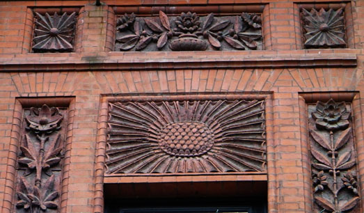 Carved bricks in a floral pattern on a building exterior