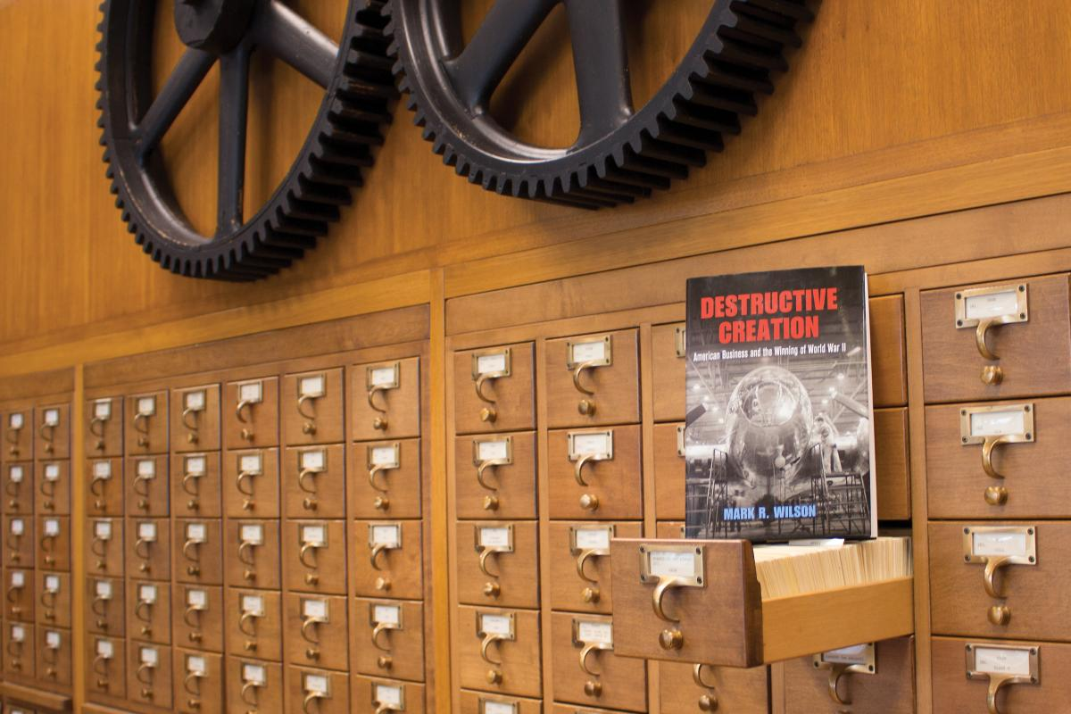 "The book ""Destructive Creation"" in front of library catalog drawers at Hagley Library."
