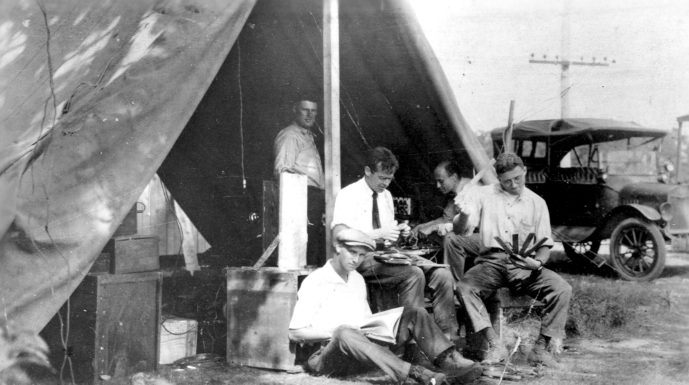 Men working in a tent
