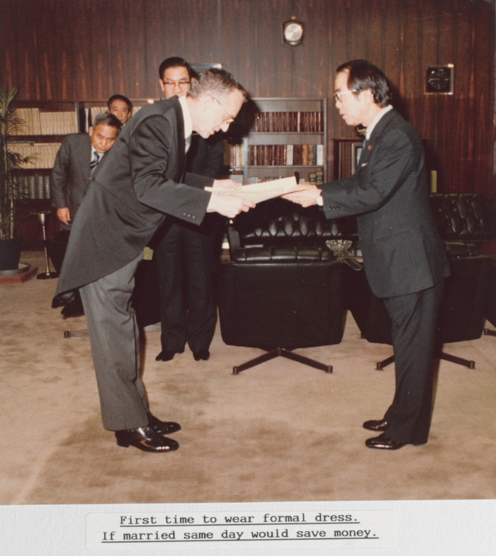 Jennings receiving the Order of the Sacred Treasure, Third Class, from the Minister of Posts and Telecom