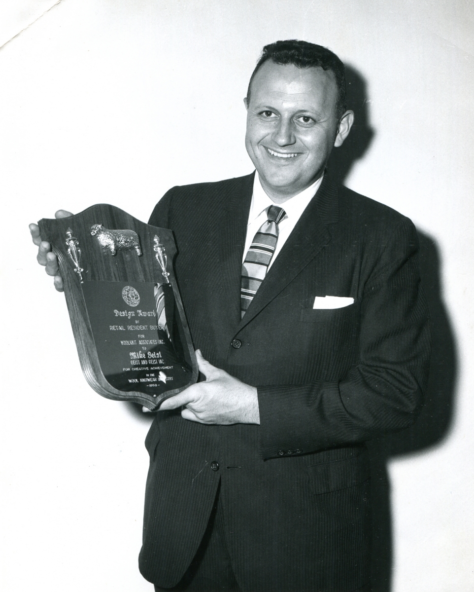 Mike Geist holds a Design Award plaque that he was awarded, 1958
