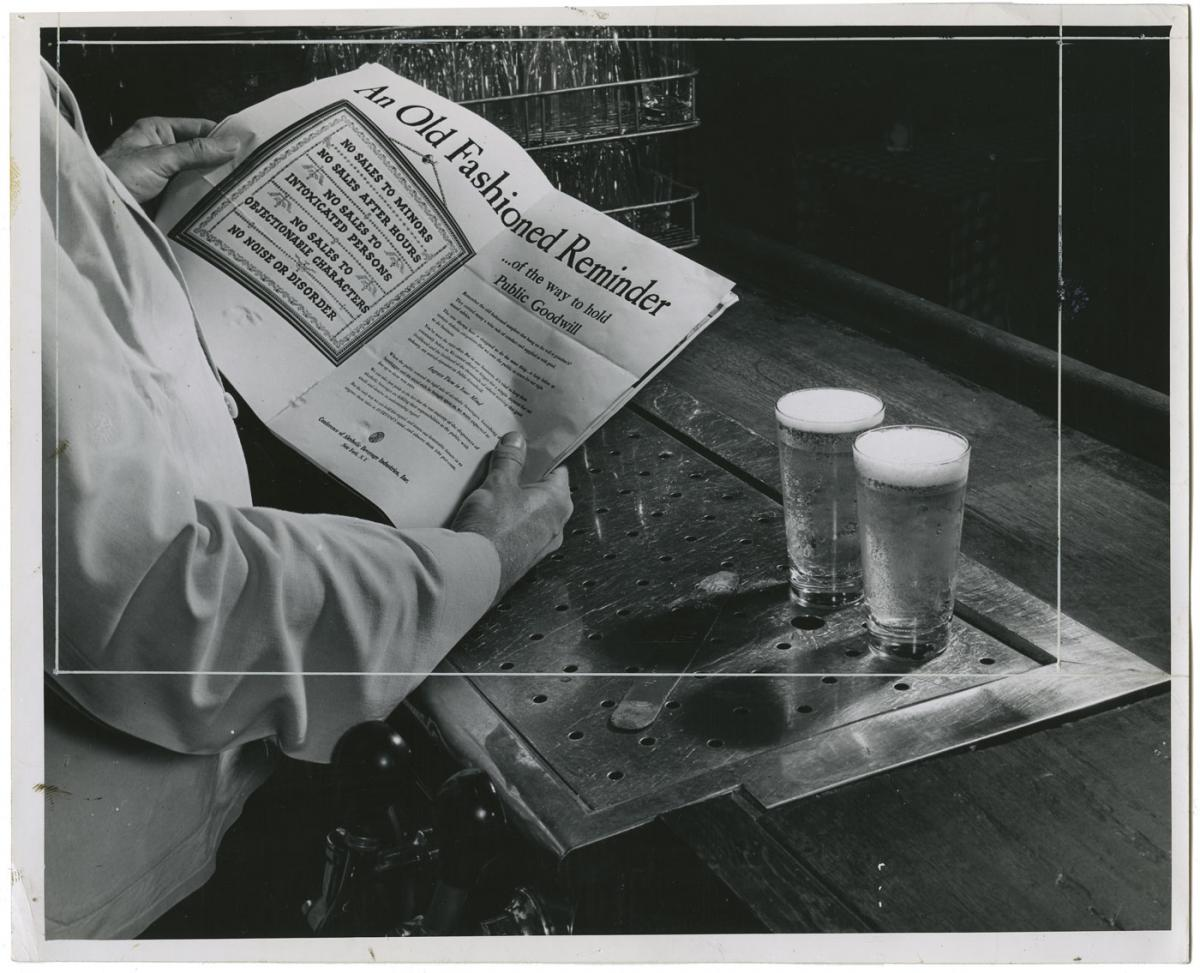 A man reads warnings about beer sales