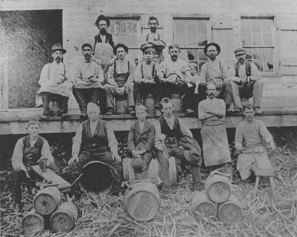 Employees of E.I. du Pont de Nemours & Co.'s wooden keg mill pose with barrels in 1880