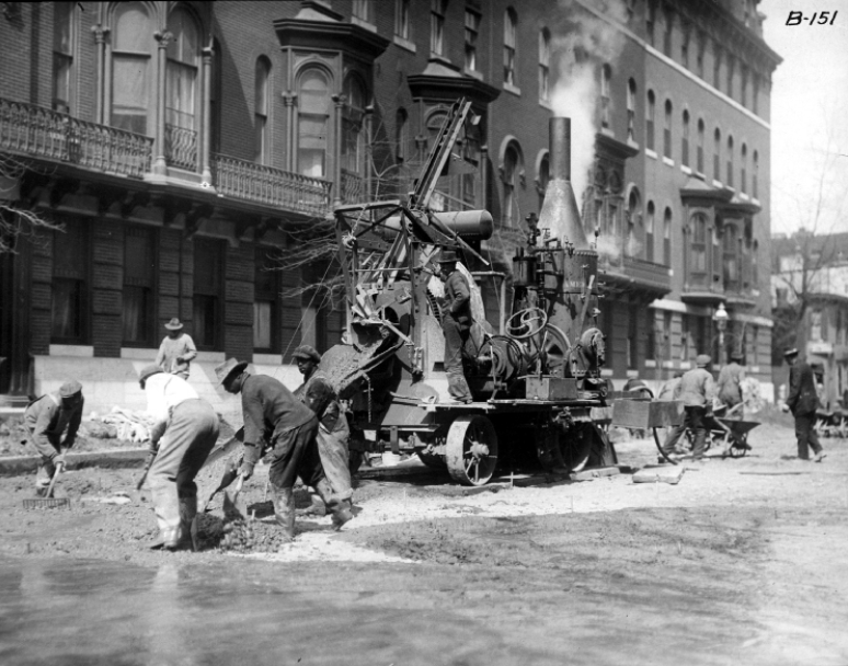 Road crew in Baltimore using Foote concrete mixer, 1915