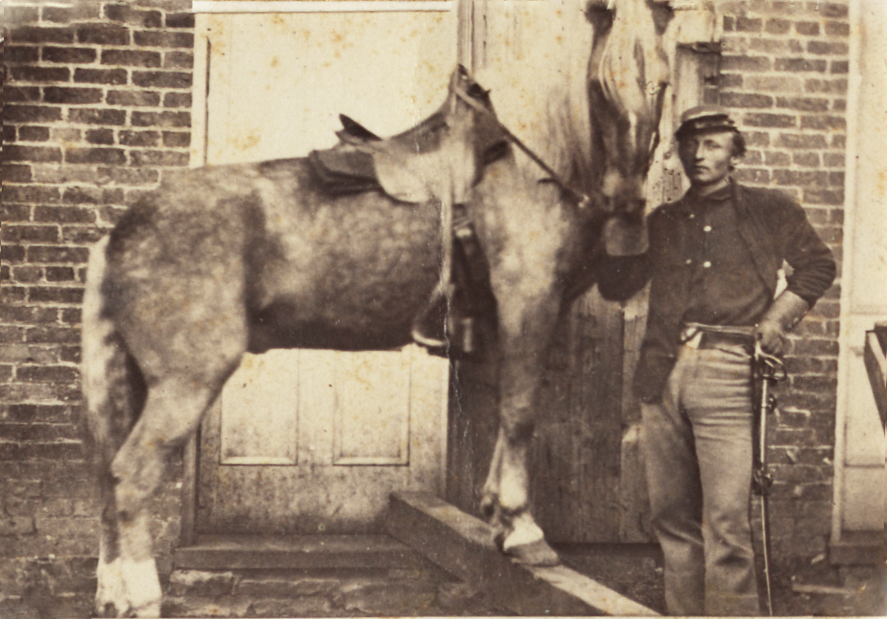 Richard Wende in uniform with horse
