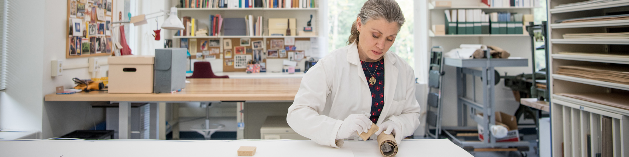 A library conservator works on a project in the conservation lab.
