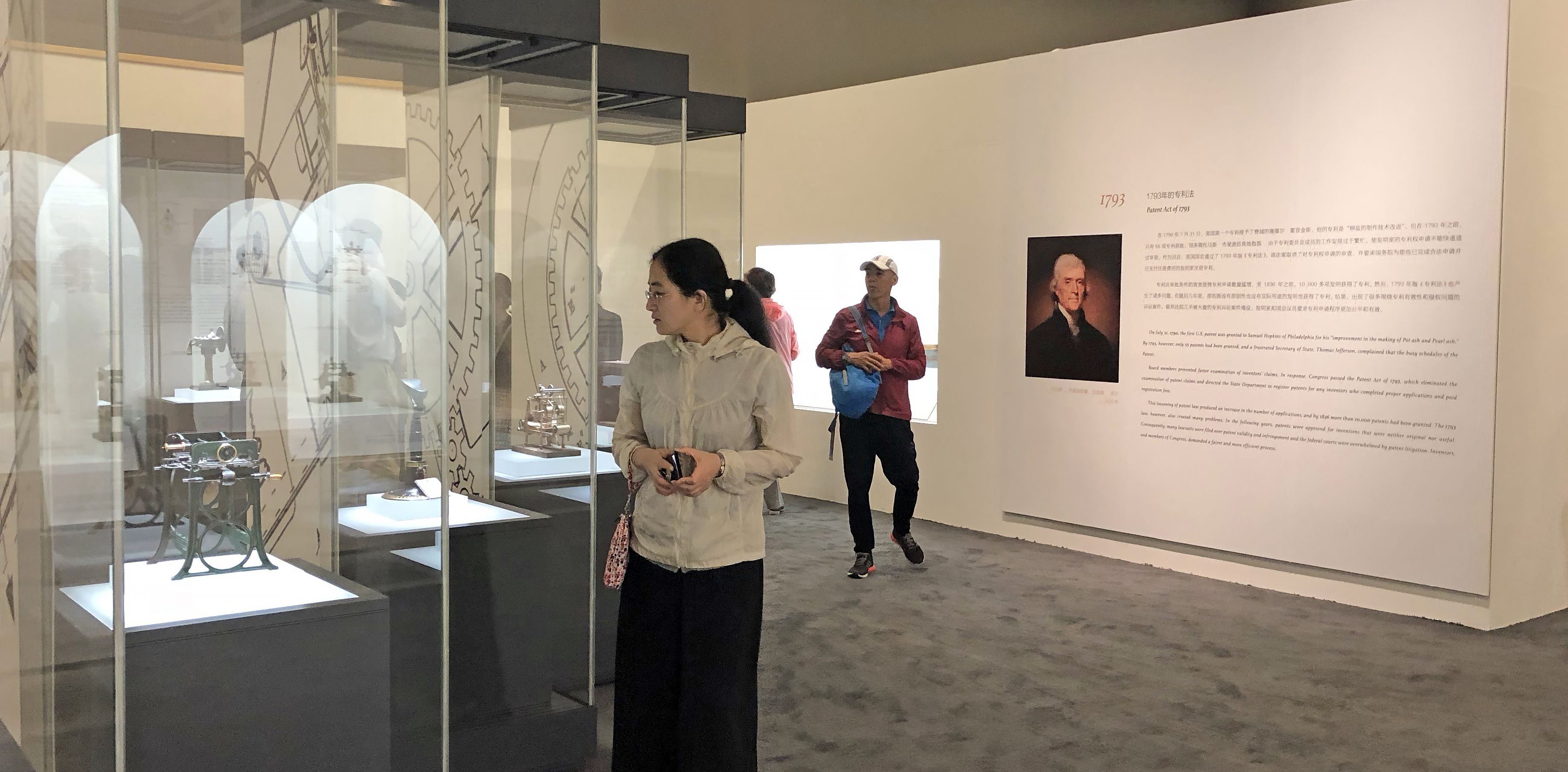 Visitors at the National Museum of China view Hagley's patent models.