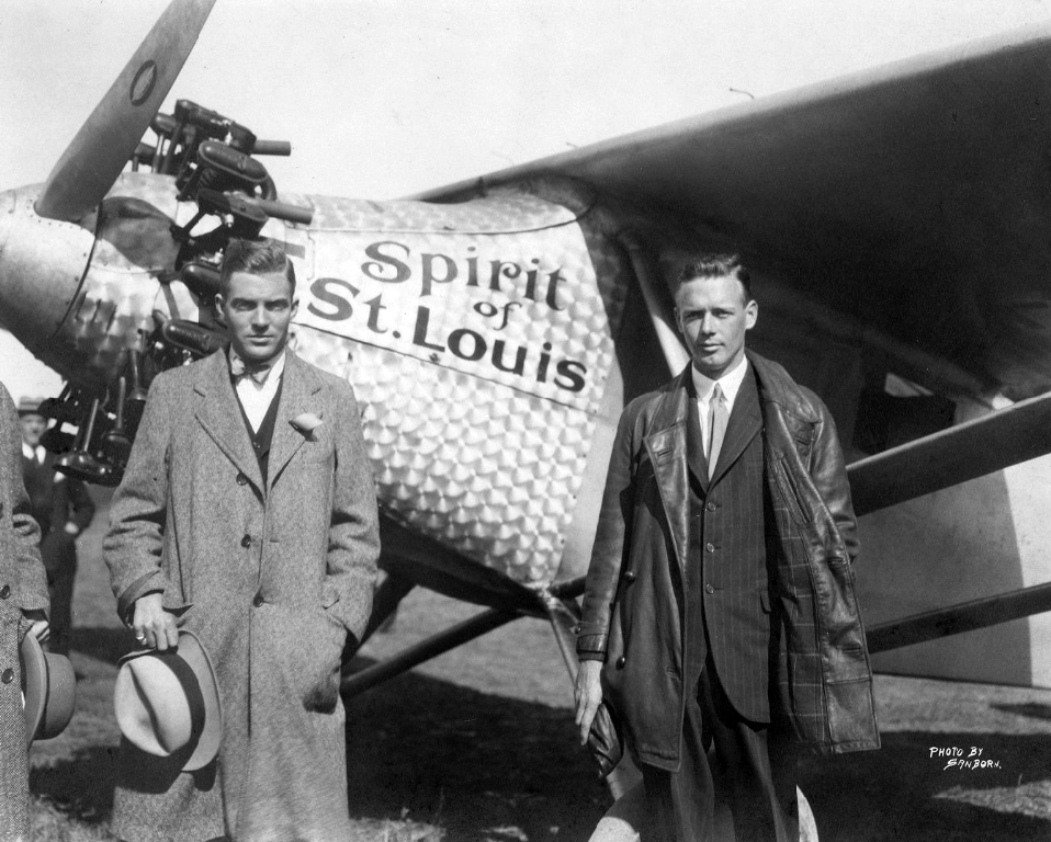 Henry Belin du Pont and Charles Lindbergh pose near his plane Spirt of St. Louis
