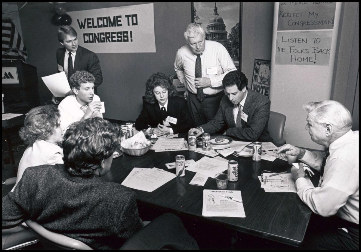 NAM members play their Congressional Insight game around a conference table.