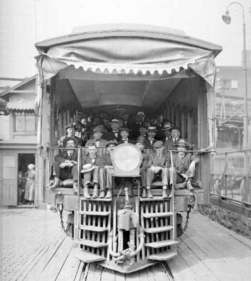 Railroad employees on traincar