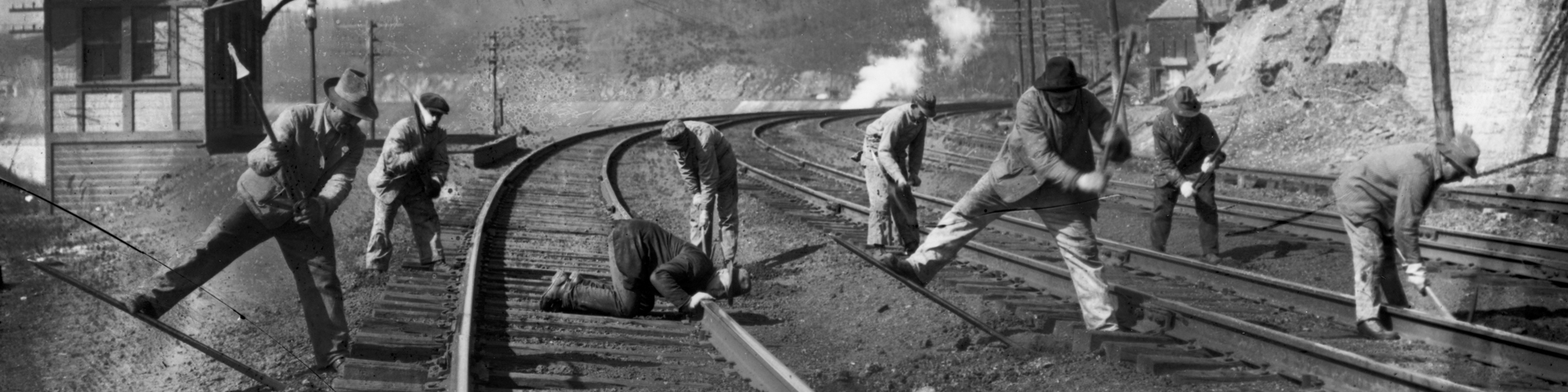 Railroad workers leveling tracks