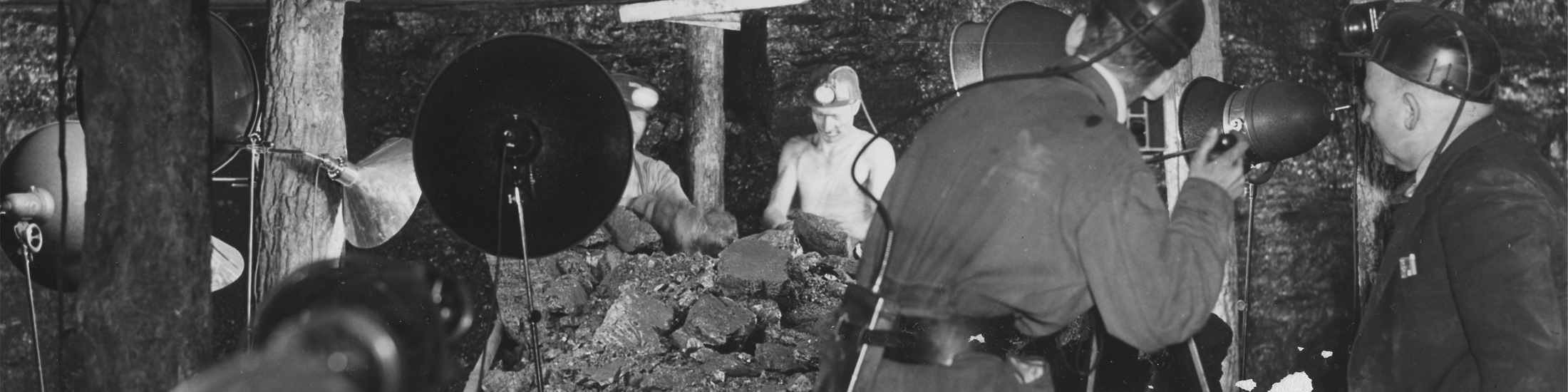 Coal miners in West Virginia are filmed by a tv crew with cameras