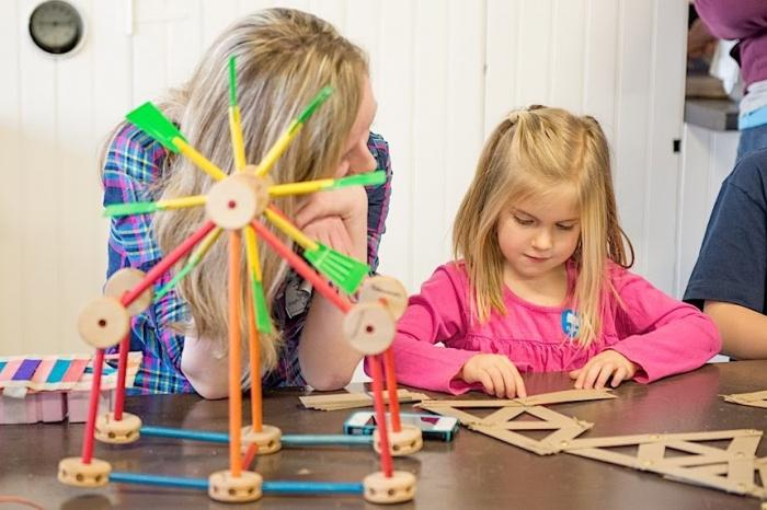 Visitors build a science experiment.