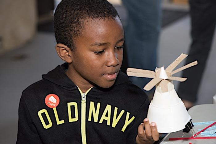 A visitor looks at his completed science experiment.