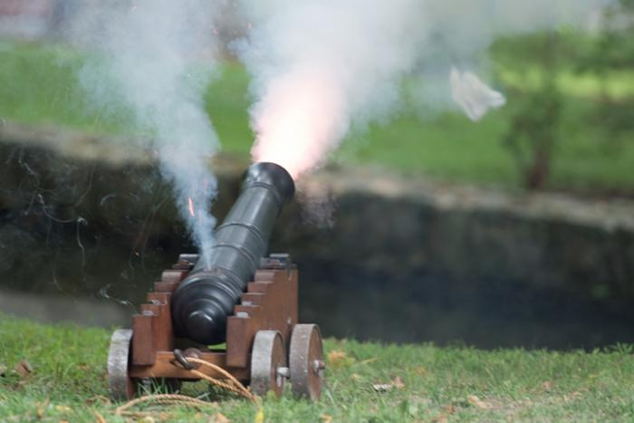 A canon fires off in the powder yards.