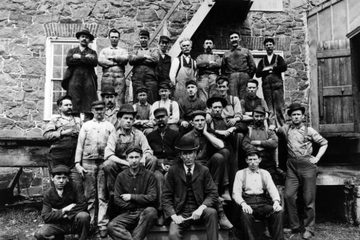 Powder yard workers pose for a group photo.