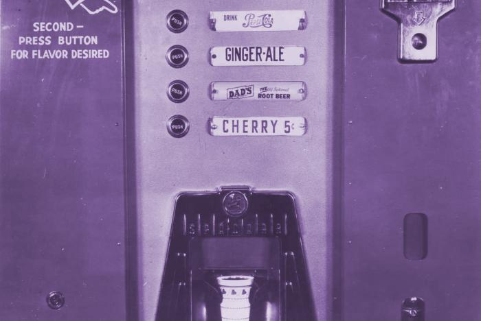 Archival image of a 1955 soda vending machine