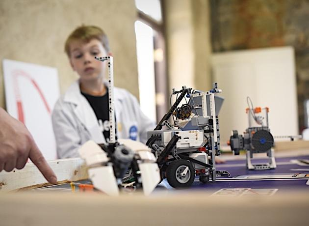 Boy looking at robot