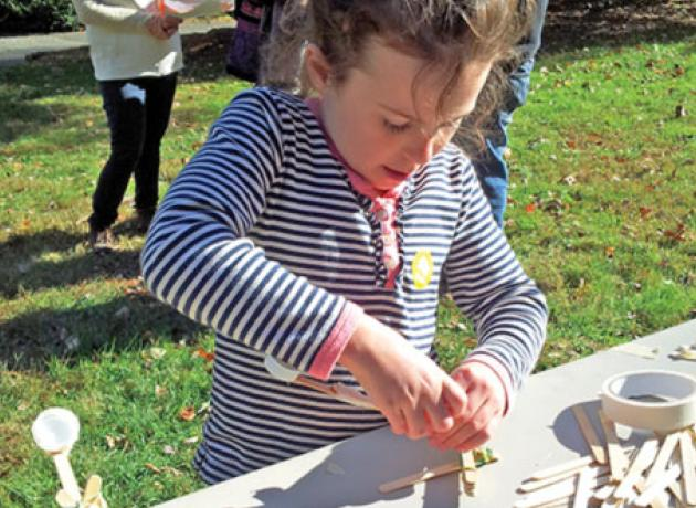 A young visitor builds a catapult at Hagley