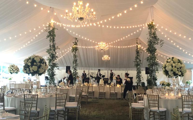 band sets up at tented ceremony