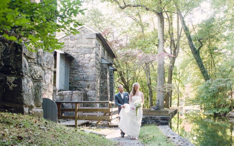 bride and groom by water wheel