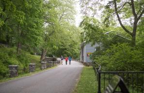 Visitors walk the path at Hagley.