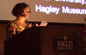 woman speaking behind podium at Hagley
