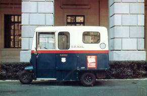 Undated color photograph of a three-wheeled U.S. Mail delivery vehicle.