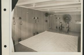 Black and white image of a fitness room with workout equipment on board the S.S. Lurline.