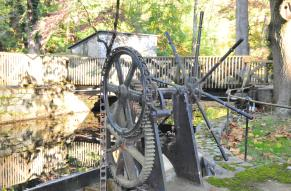 A turbine used to start water power on the museum grounds.