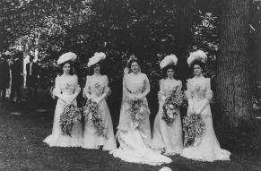 Black and white group photo of Louise du Pont Crowninshield on her wedding day with her bridesmaids.