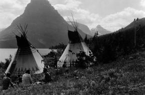 Black and white photograph of Blackfeet on shore of Two Medicine Lake Glacier National Park