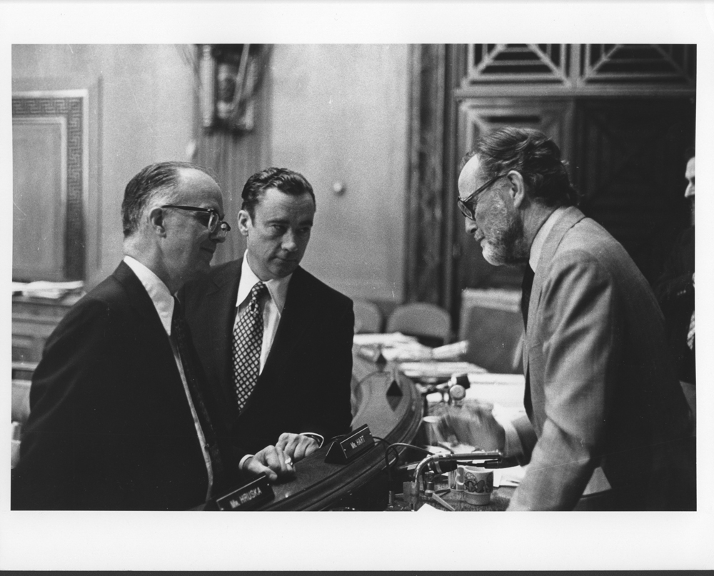 William G. McGowan and Kenneth Cox speaking with a senator